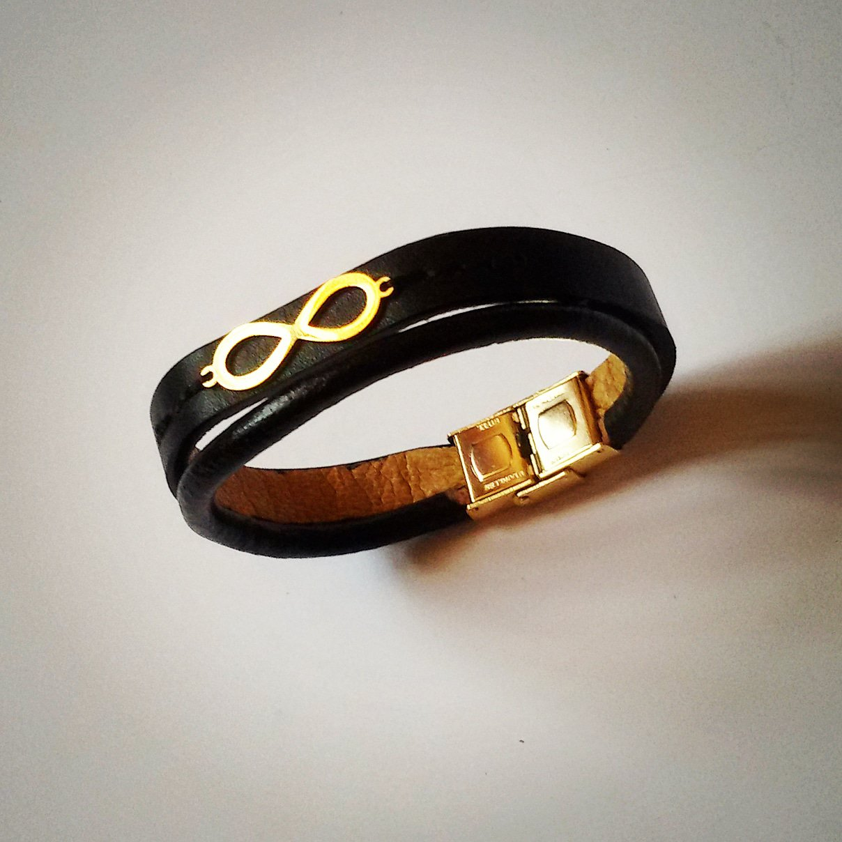 دستبند چرم طرح بینهایت