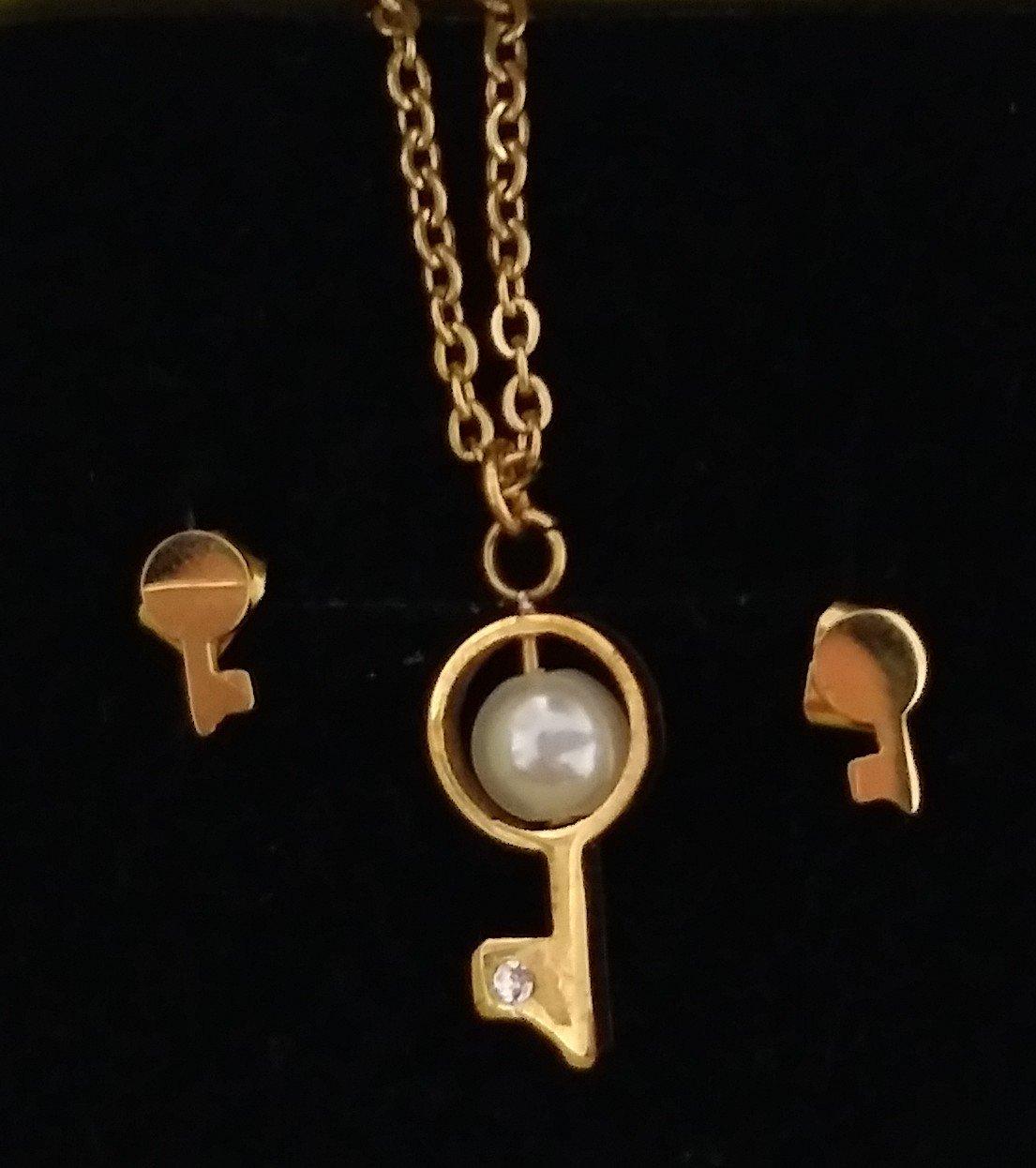 نیم ست استیل طرح کلید طلایی